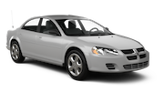 PAYLESS Car rental Radisson Crystal City Standard car - Dodge Stratus