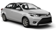 DOLLAR Car rental Dubai - Downtown Economy car - Toyota Yaris Sedan